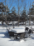 Backyard patio furniture in winter Stock Images