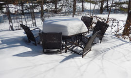 Backyard patio furniture in winter Royalty Free Stock Photography