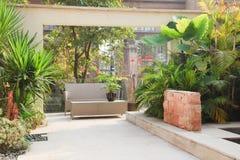 Backyard Patio in Garden. Backyard with cane chair and tree in a Garden Royalty Free Stock Photos