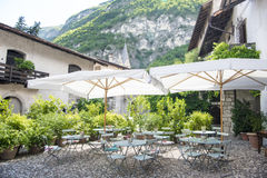 Backyard patio in Italy. Backyard terrace of wine bar in Italy stock photos