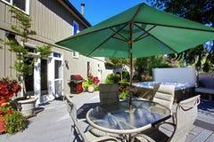 Backyard with patio and jacuzzi Stock Image