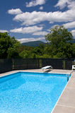 Backyard Pool. Picture of a pool in a scenic backyard with mountains and blue skies in the back ground Stock Images