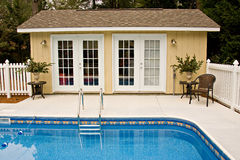 Backyard pool house. Small backyard swimming pool and pool house affordable home projects Stock Image