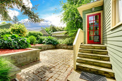 Backyard porch with red french door Stock Image
