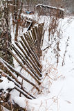 Backyard rickety fence in winter Stock Photo