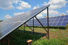 Backyard solar panels for residential house energy efficiency stock images