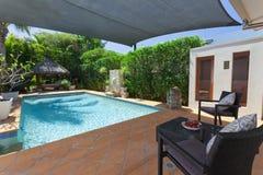 Backyard with swimming pool Stock Photos