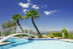 Backyard with swimming pool and little bridge Stock Photography