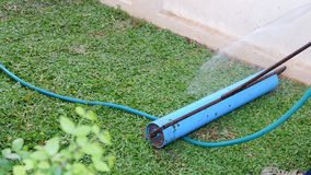Backyard, tool of yard work planting a new sod grass. In garden Stock Image
