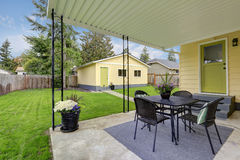 Backyard view with covered patio area . Royalty Free Stock Photo