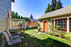 Backyard view of craftsman house with a shed Royalty Free Stock Photo