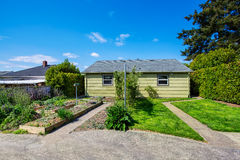 Backyard view of two family house with vegetable beds. Stock Photo
