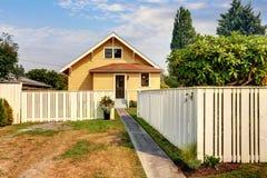 Backyard view of yellow siding craftsman house. Royalty Free Stock Photos