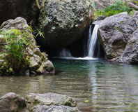 Backyard Waterfall. Little waterfall at a peaceful spa called Serendipity in Kingston, Jamaica stock image