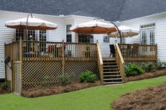 Backyard Wood Deck Patio With Umbrellas. Grill And Furniture royalty free stock photos