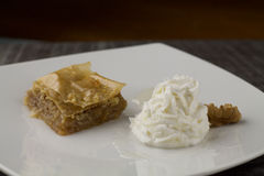 Baclava on wooden table and greek yogurt Stock Image