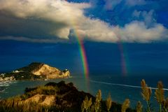 Bacoli, Capo Miseno enclosed by the rainbow. stock image