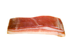 Bacon. Raw bacon slices isolated on white Royalty Free Stock Photography