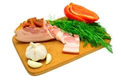 Bacon, aneto, pepe ed aglio su un bordo Fotografie Stock