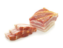 Bacon Big and Sliced. Bacon big with slices against white background stock images