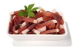 Bacon bits. On white background Royalty Free Stock Photo