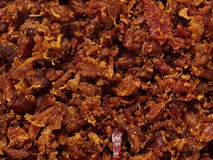 Bacon bits texture background Stock Photography