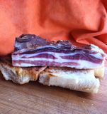 Bacon with bread. Dry bacon with toasted bread Stock Photos