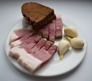 Bacon with bread and garlic royalty free stock photography
