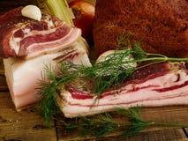 Bacon and bread. Bacon and onion dill garlic bread Royalty Free Stock Photo