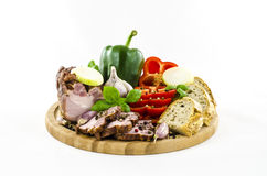 Bacon and bread with vegetables on wooden board Stock Photo
