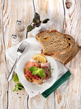 Bacon and bread on a wooden table Royalty Free Stock Image