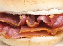 Bacon Breakfast Roll Sandwich. Crispy bacon in a soft white bread roll Stock Images