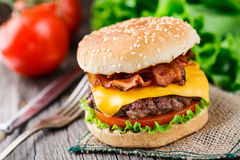 Bacon burger with beef cutlet Stock Images