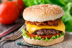 Bacon burger with beef cutlet Royalty Free Stock Photos