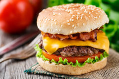 Bacon burger with beef cutlet Stock Photos