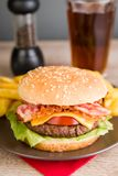 Bacon burger with french fries Royalty Free Stock Images
