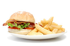 Bacon burger and fries. On a plate Stock Photography