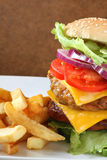 Bacon burger with fries Royalty Free Stock Image