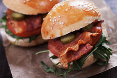 Bacon burger with tomato and rocket salad Royalty Free Stock Image