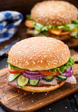 Bacon burger with vegetables and cutlet Stock Image