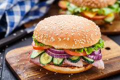 Bacon burger with vegetables and cutlet Stock Images