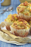 Bacon cheddar muffins. Fresh baked bacon cheddar muffins wicker tray on blue background Royalty Free Stock Photography