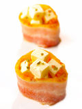 Bacon with cheese. Delicious bacon and cheese appetizer Stock Image