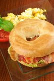 Bacon and cheese bagel with scrambled eggs Stock Photo