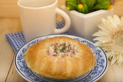 Bacon cheese bun on plate with cup of coffee Stock Images