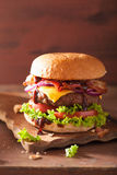 Bacon cheese burger with beef patty tomato onion Royalty Free Stock Images