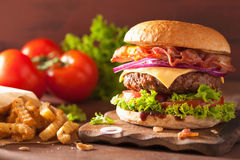 Bacon cheese burger with beef patty tomato onion Royalty Free Stock Photo