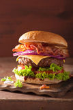 Bacon cheese burger with beef patty tomato onion Stock Photography