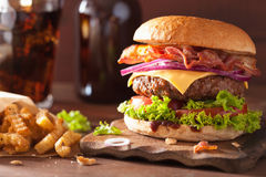 Bacon cheese burger with beef patty tomato onion Stock Image