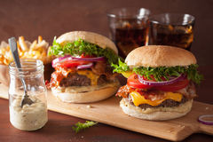 Bacon cheese burger with beef patty tomato onion Stock Photos